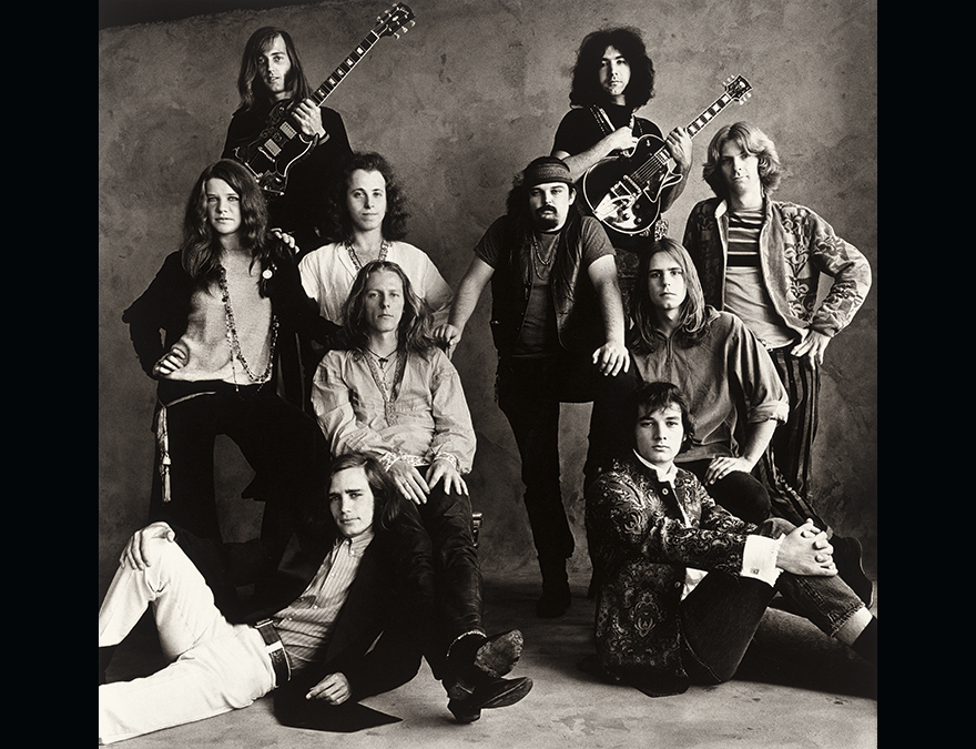 black and white photo of two rock groups