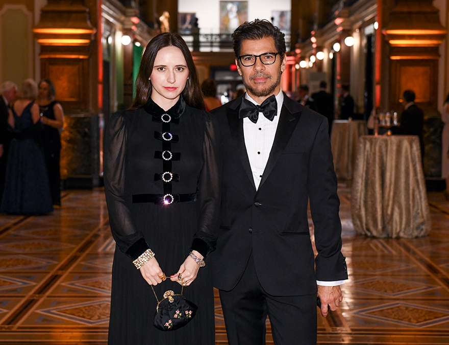 Woman and  man in black formalwear standing in the Great Hall