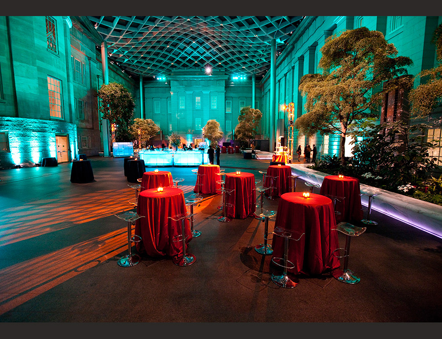 Courtyard with acqua lights and orange tables