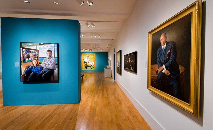 View of the exhibition, portraits on gallery walls.