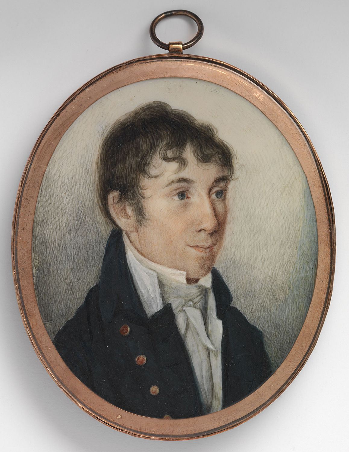 Small painted portrait of a man in a gold frame