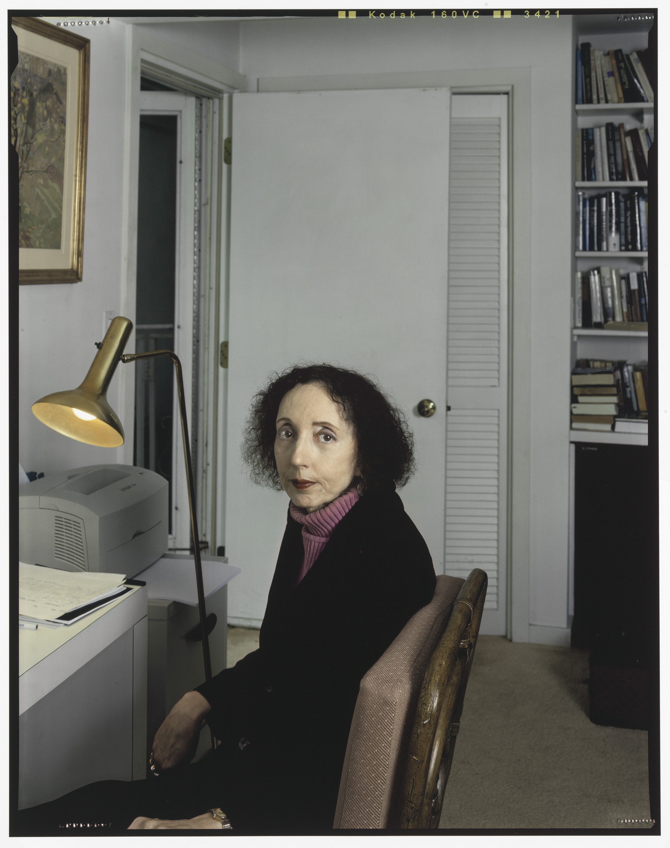 Photograph of a middle aged woman sitting in a study