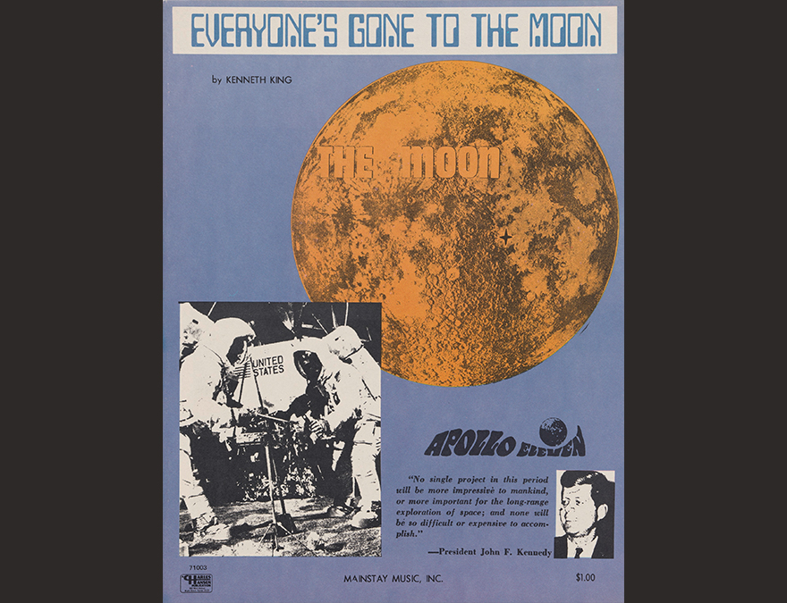 Poster with the moon and astronauts and a small photo of JFK