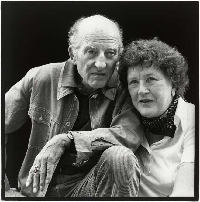 Black and white image of a man and a woman with their heads together