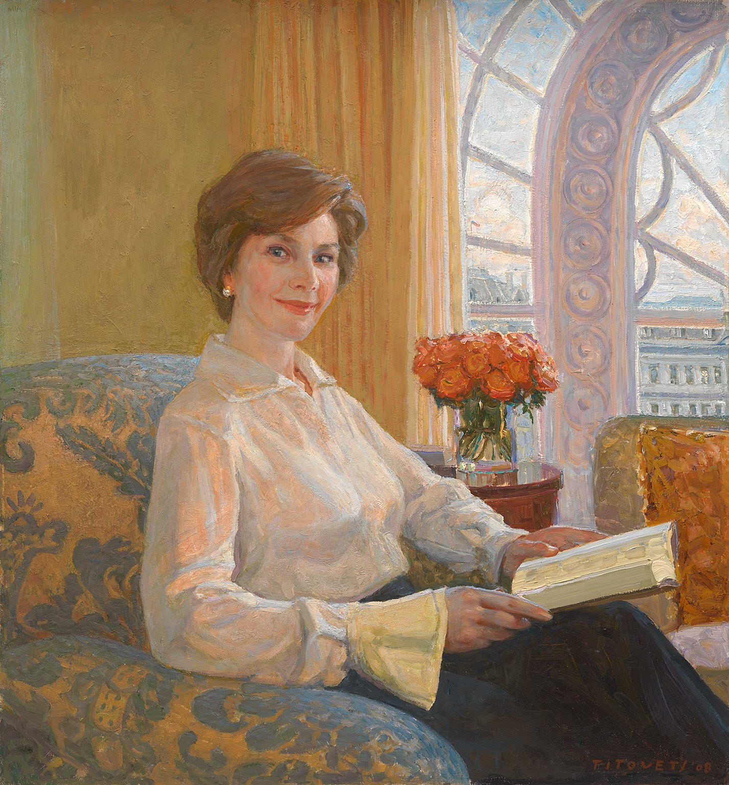 Painting of a woman in a white blouse sitting in a chair and looking up from a book