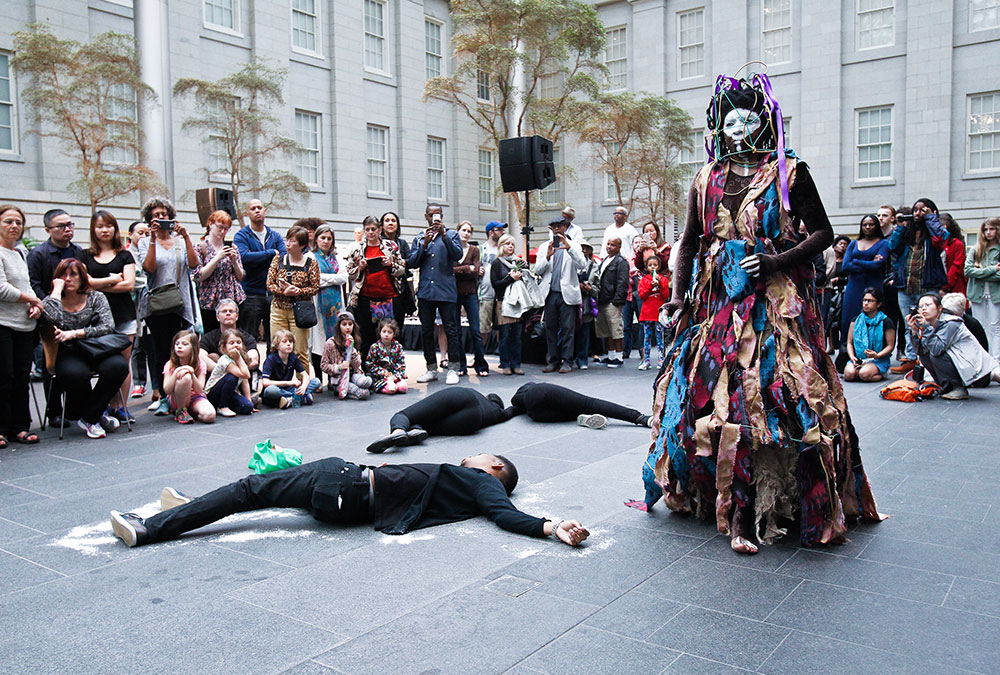 María Magdalena Campos-Pons in costume performing in the Kogod Courtyard
