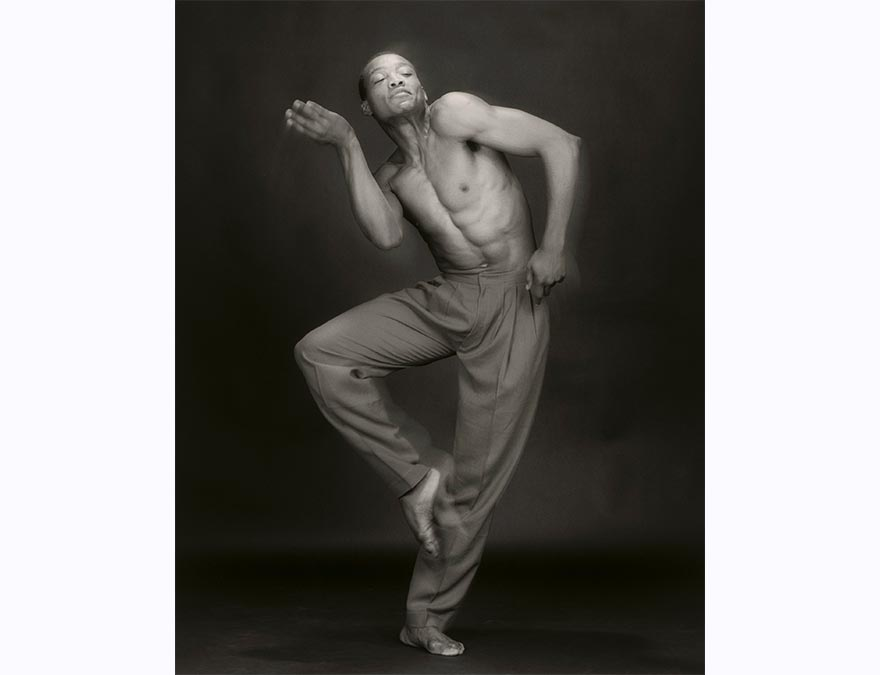 full-length photo of a shirtless African American man dancing.