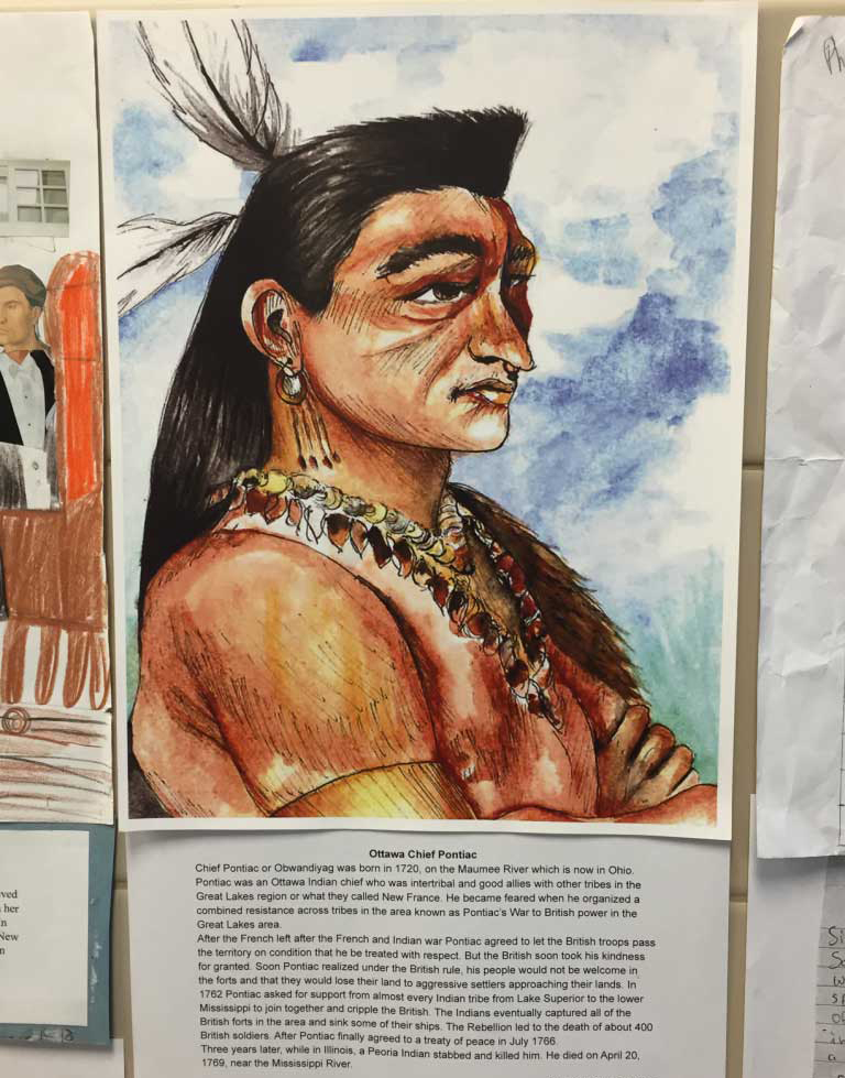 Portrait of a man wearing traditional native american garb