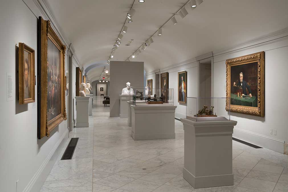 View of exhibition, portraits on white walls in museum gallery