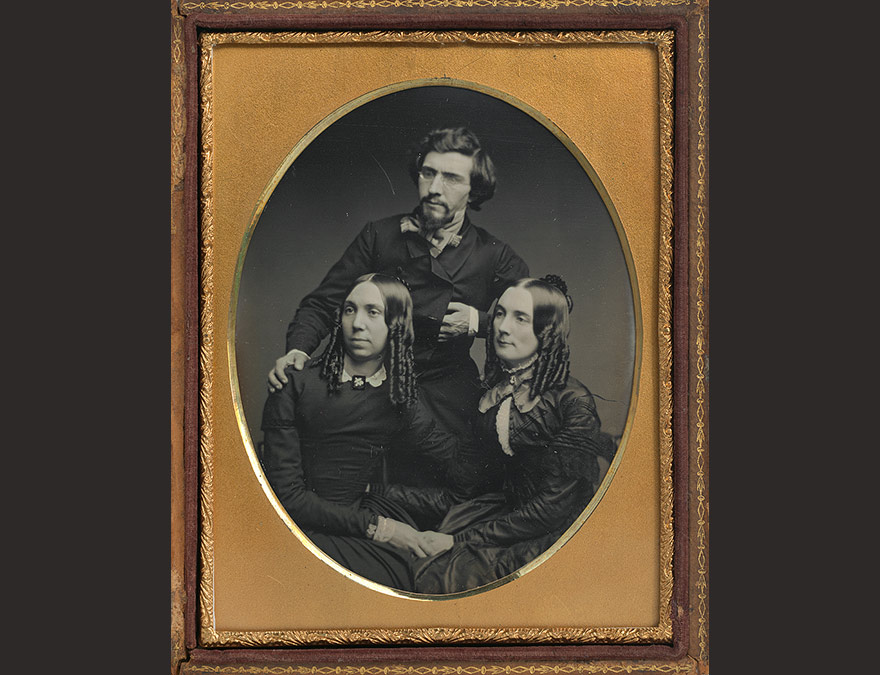 Photograph of a man (Mathew Brady) and two women