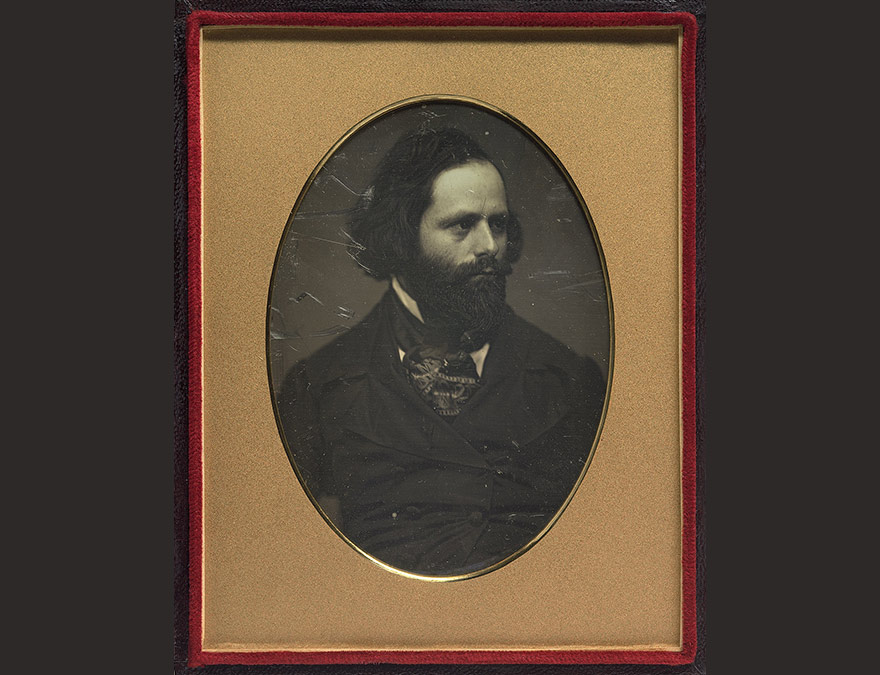 Photo of a bearded man in a gold frame