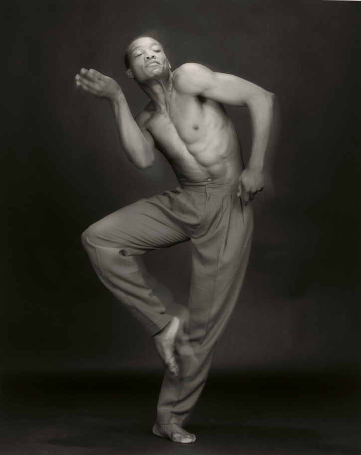 Black and white photograph of a man dancing