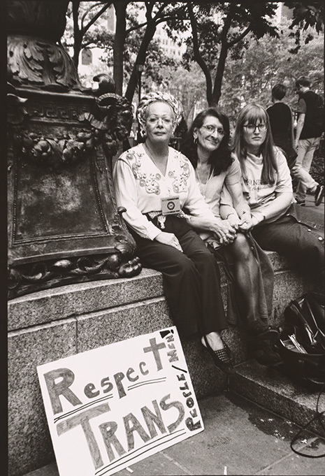 "Black and white photo of Sylvia Rivera (with Christina Hayworth and Julia Murray) with sign reading ""Respect Trans"""