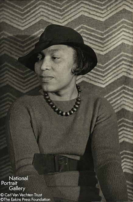 Black and white image of a well-dressed woman looking to the left