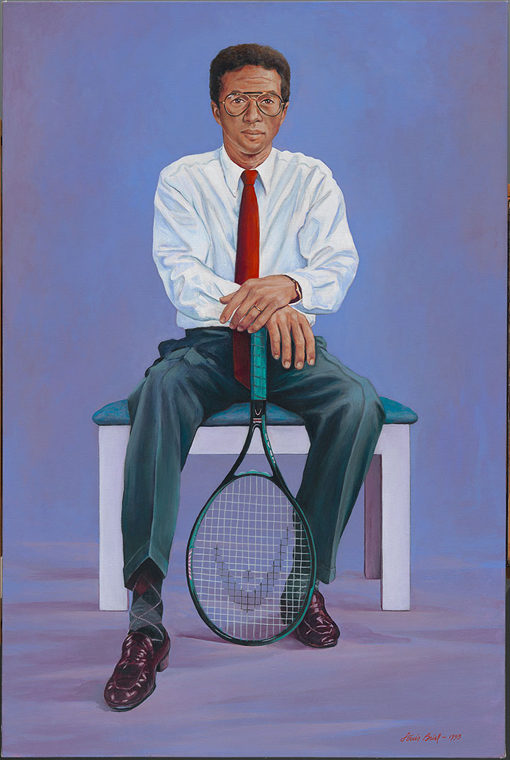 Seated man with a tennis racket