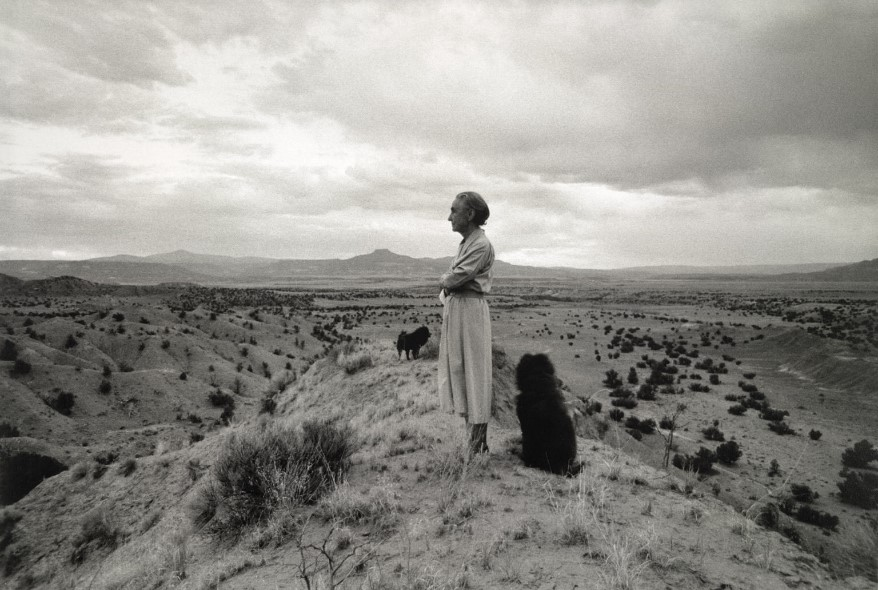 Georgia O'Keeffe and chows her dogs