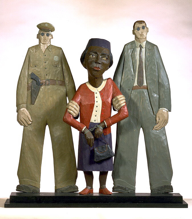 Painted wooden sculpture of a handcuffed Rosa Parks being arrested by two white police officers