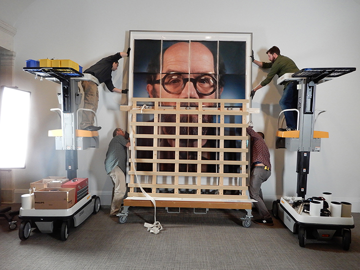Installation of Chuck Close's self-portrait