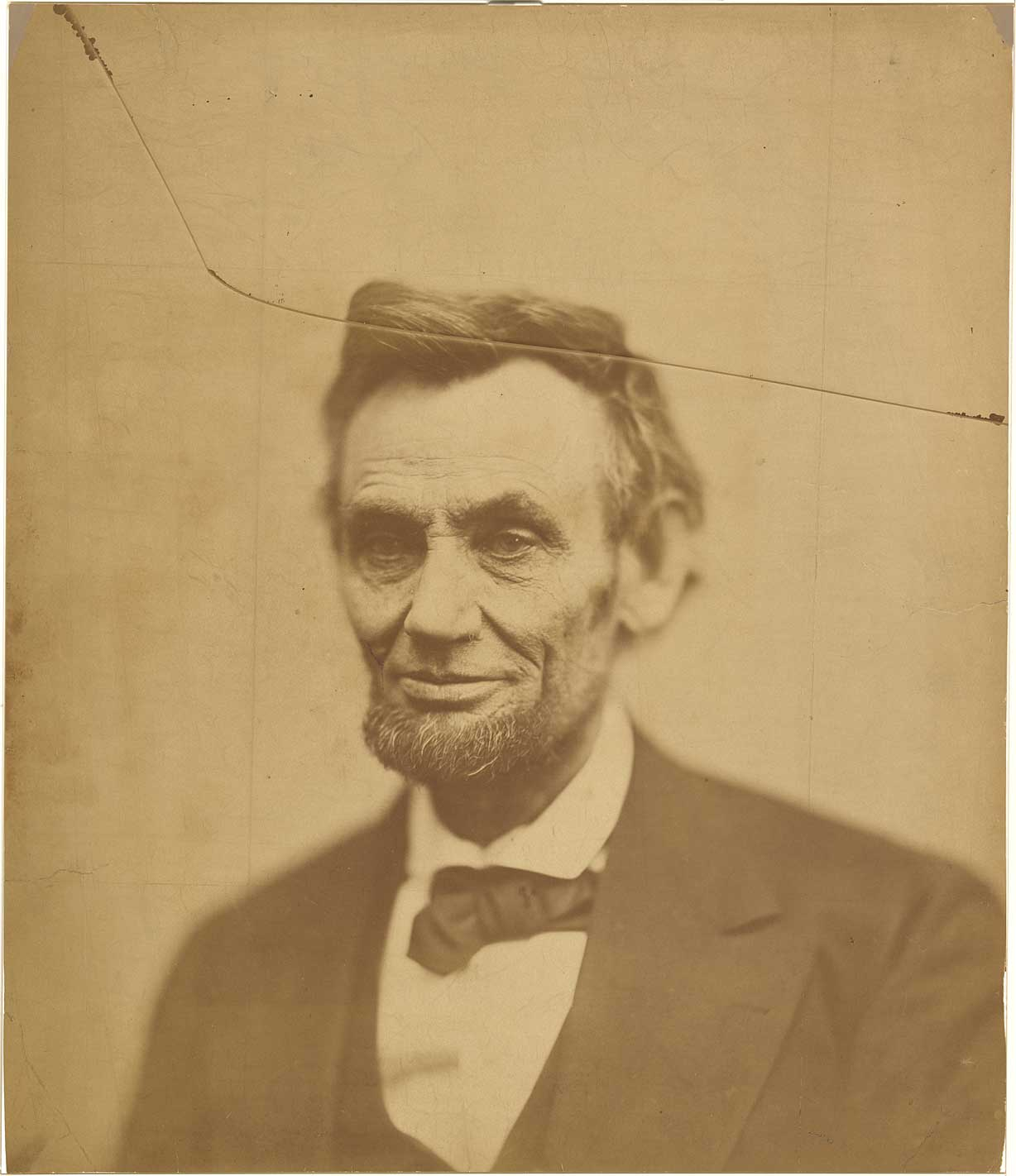 Photograph of a man with a line going through the top of his head