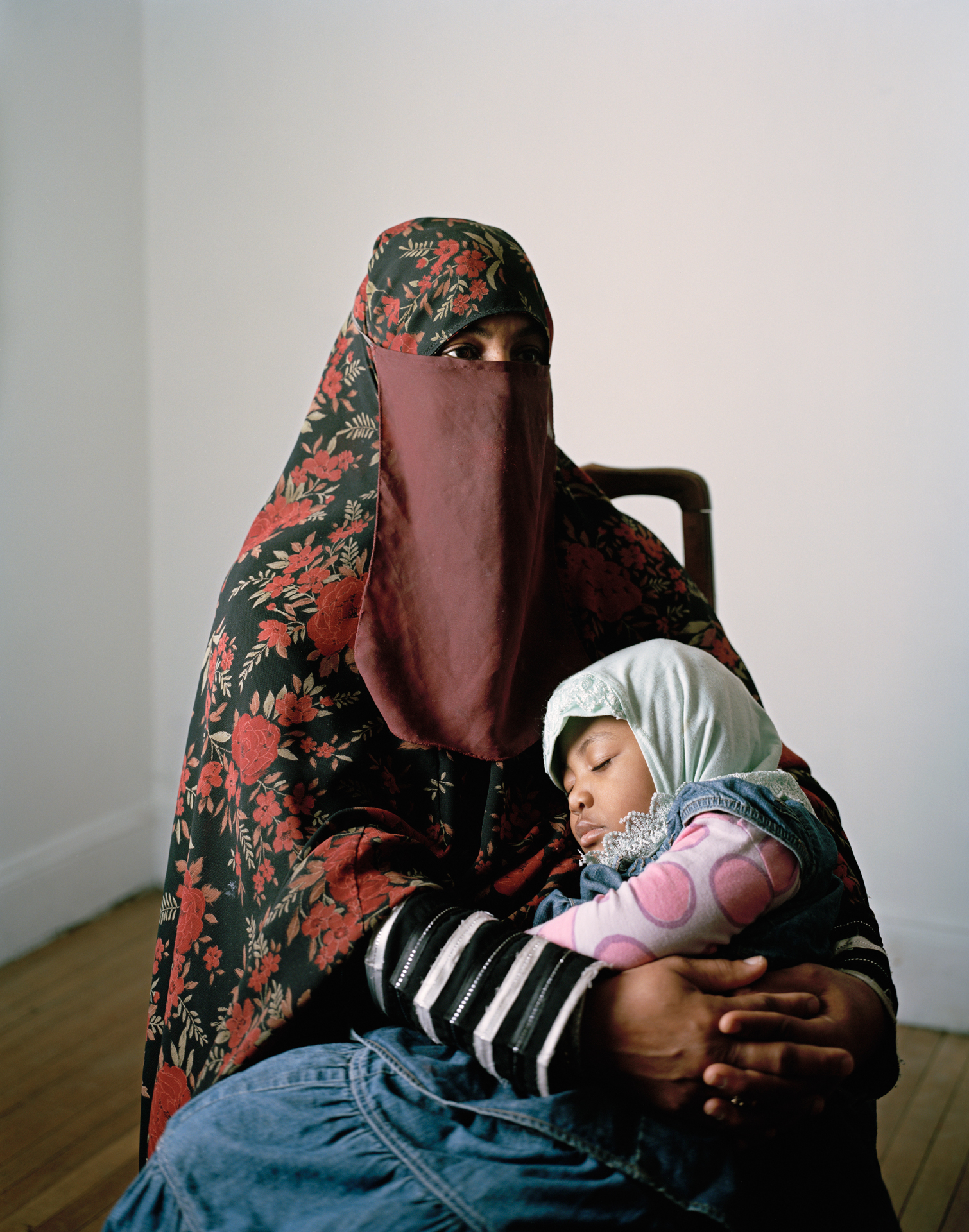 Woman in head covering, with small child