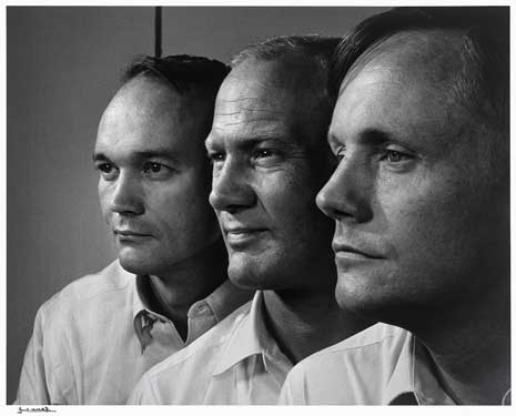 Black and white photo of the profiles of three men, each wearing collared shirts.