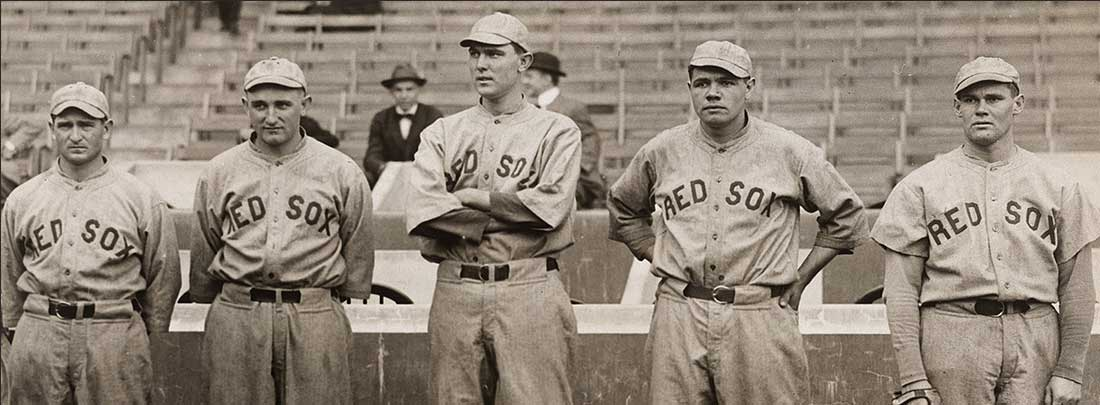 Black and white photo of Babe Ruth and other Red Sox pitchers, all in their baseball uniforms