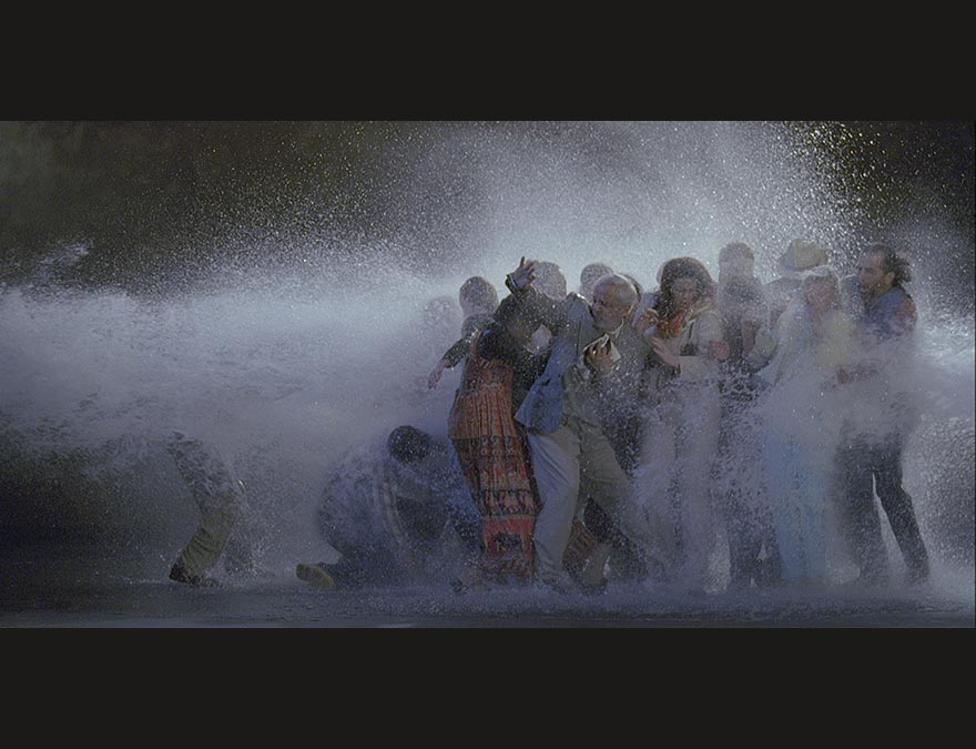 Groups of people being sprayed with water by a high-powered hose