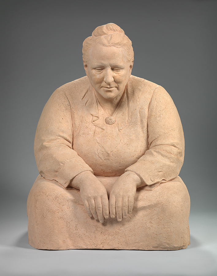 Sculpture of a seated woman