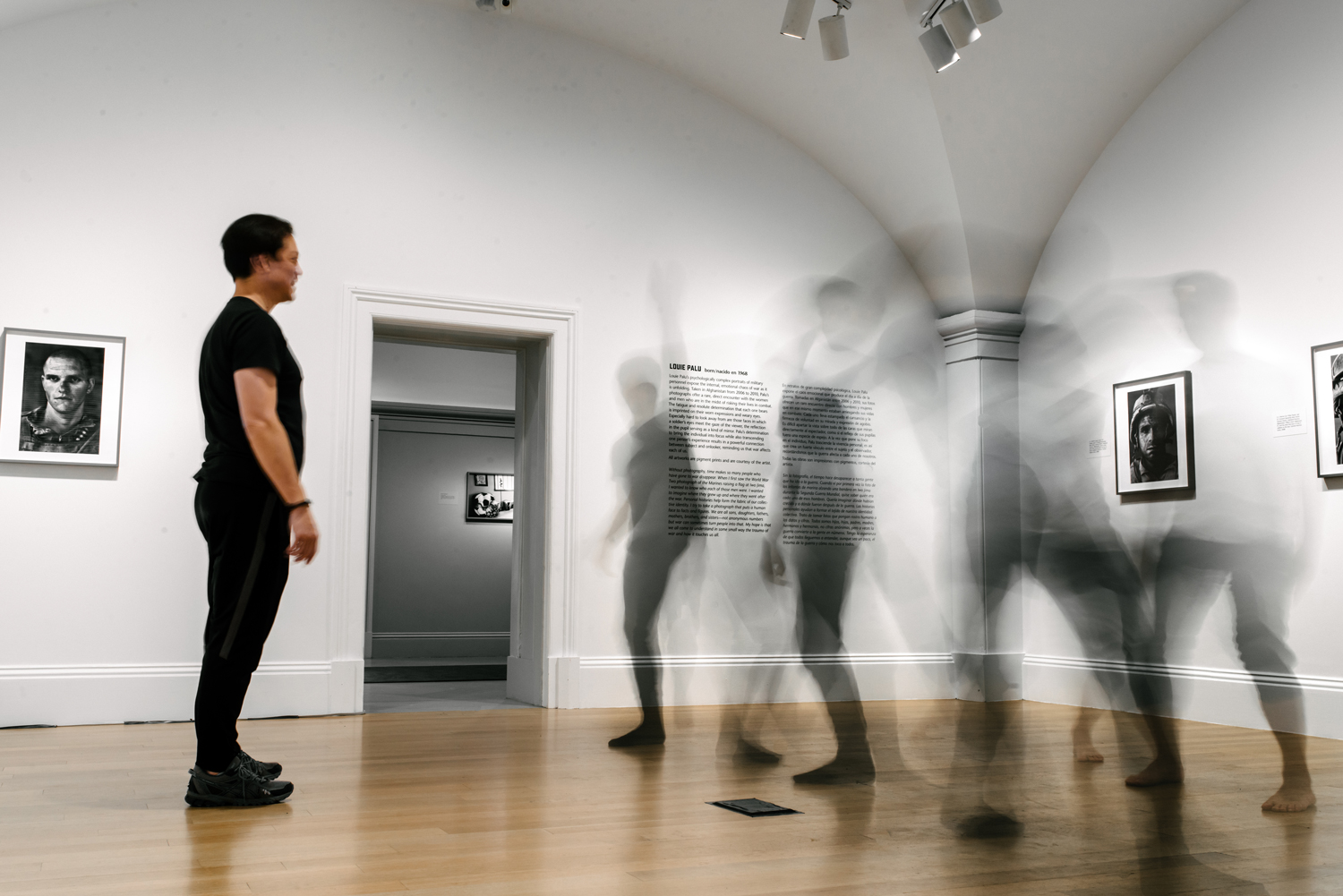 Dancers moving very quickly in a museum gallery