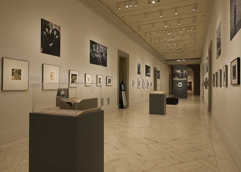 View of exhibition -- a wall with portraits