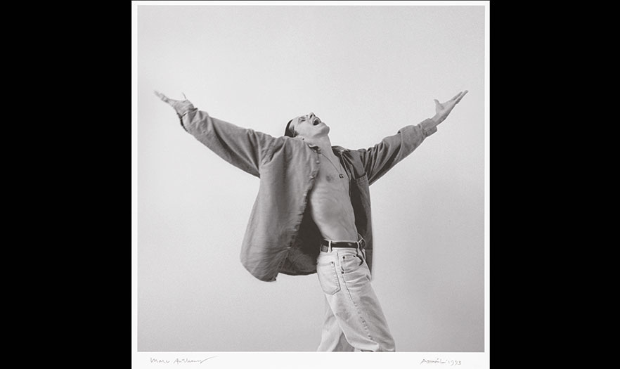 Man  with an open shirt with his arms outstretched