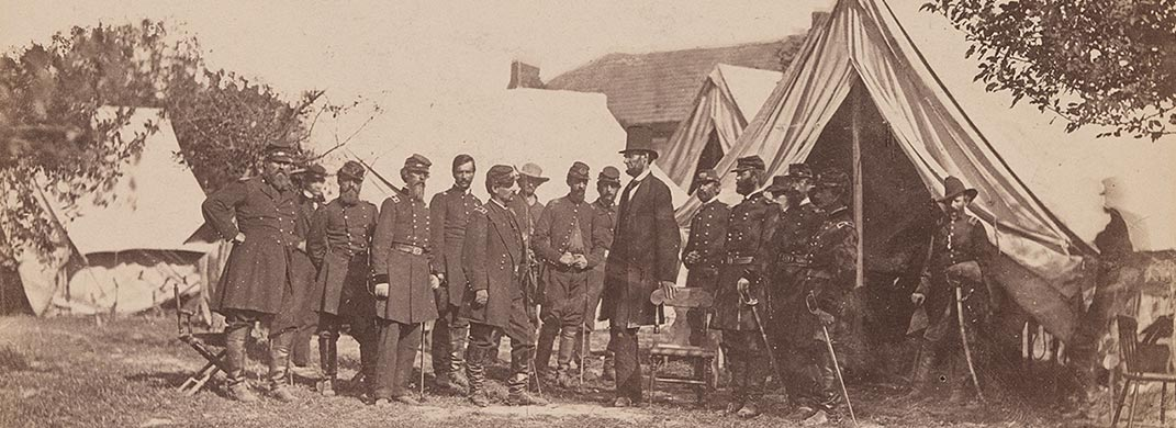 Photo of Abraham Lincoln  and officers outside a tent at the Antietam Battlefield