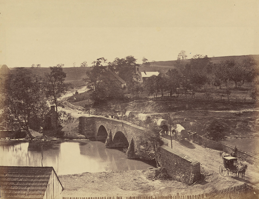 Photograph of Antietam Bridge, Maryland with army wagons crossing