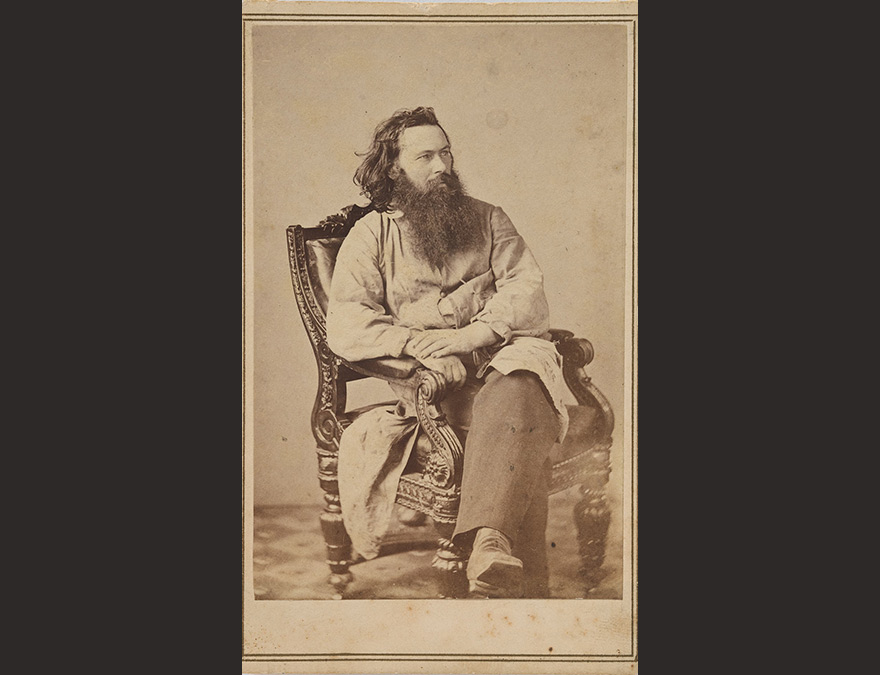 Photogra[hic portrait of a bearded man in a chair (Alexander Gardner)