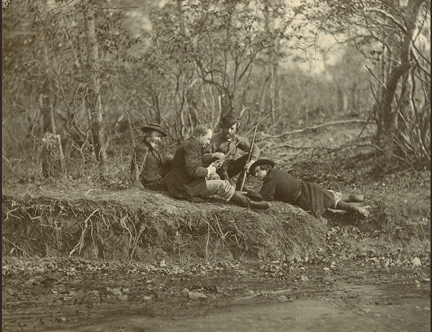 Group of men reclining in the forest