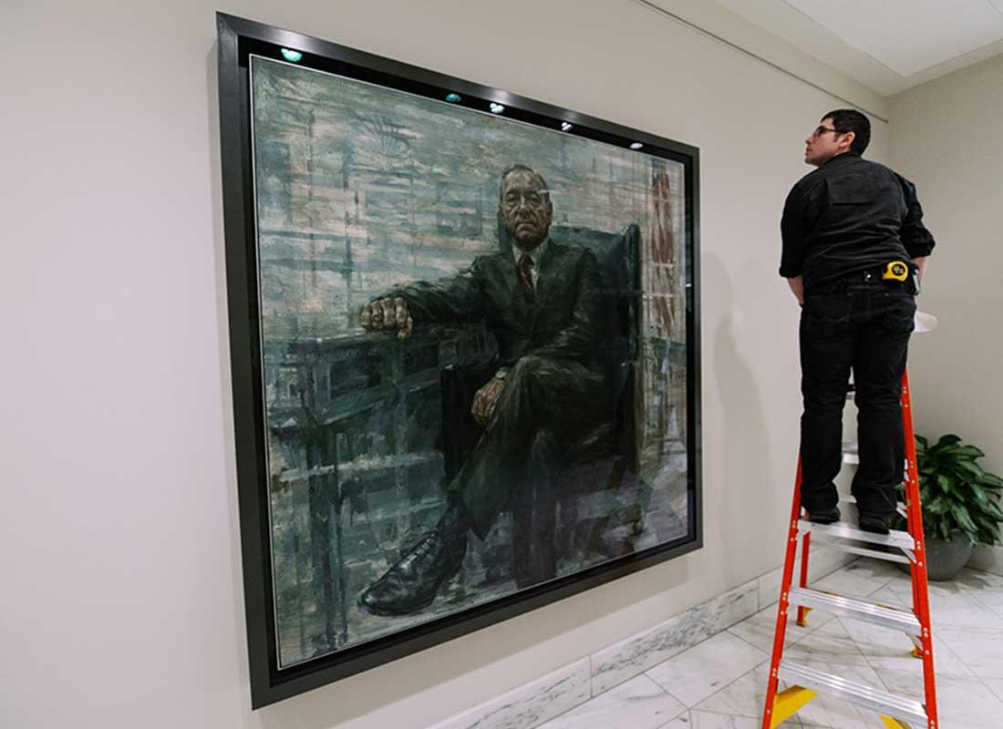 Portrait Gallery art handlers installing portrait