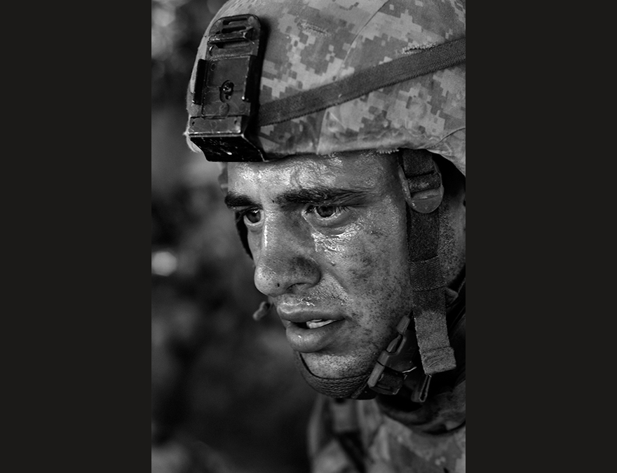 Black and white photo of a soldier in a helmet