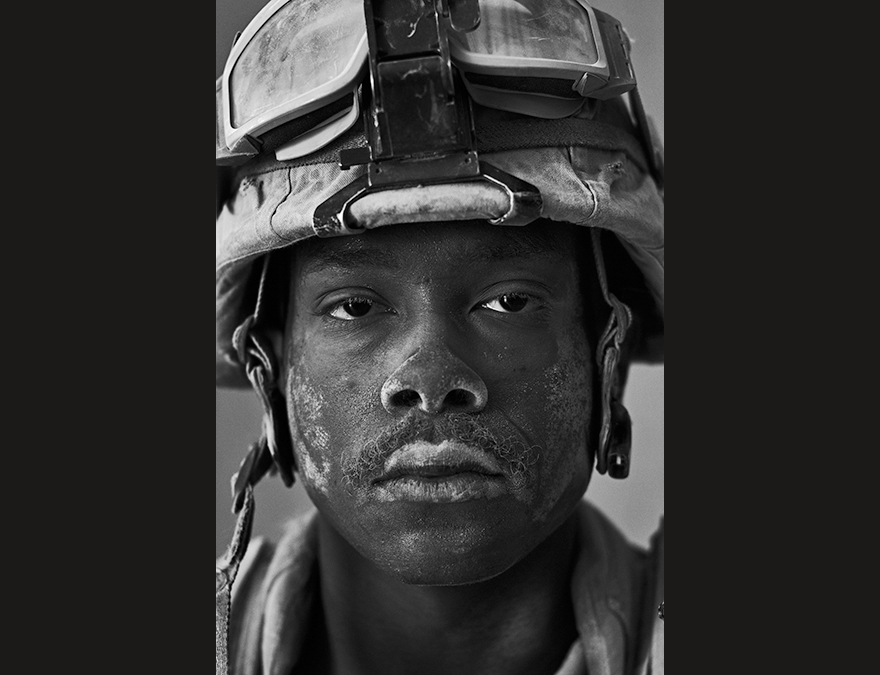 Black and white photo of a young African American soldier in a helmut