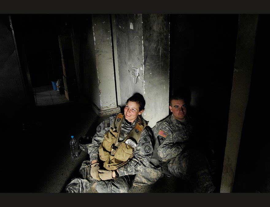 Solders (including the photographer) in a bunker in the dark