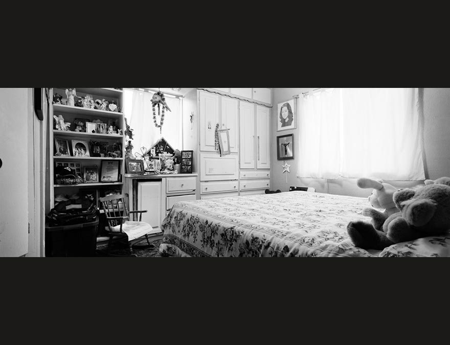 Black and white photo of a soldier's bedroom back home
