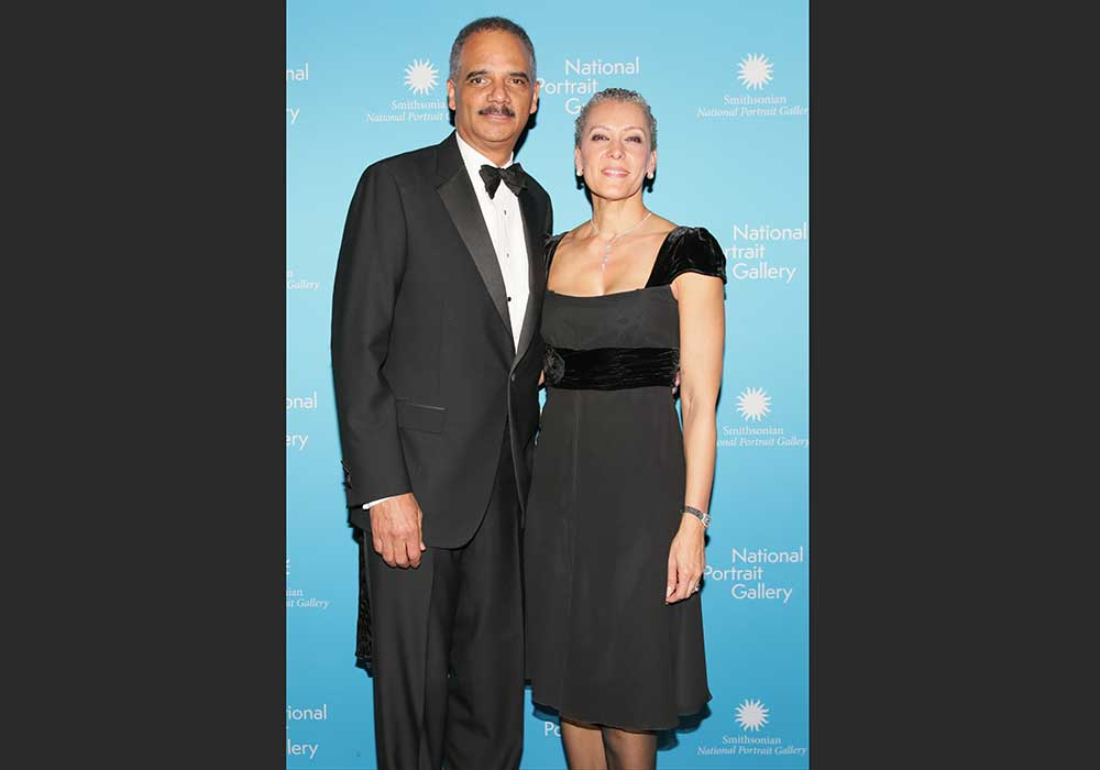 Eric Holder y Sharon Malone