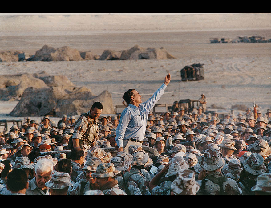 Man waving in a crowd of soldiers