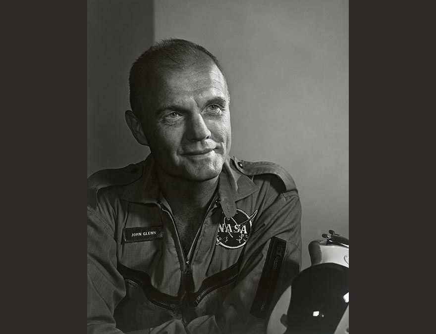 Black and white photo of a man in a flight suit