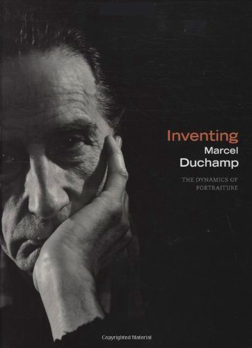"Book cover for ""Inventing Marcel Duchamp"" with black and white photo of Marcel Duchamp with hand on chin"