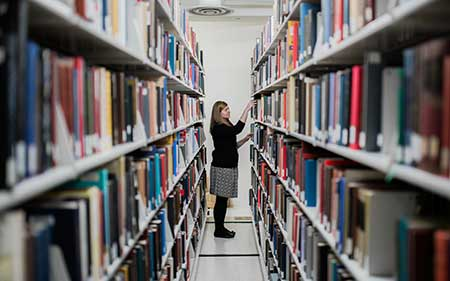 Library intern working in the library stacks