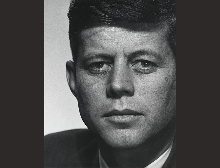 Black and white, close-up photo of a man with dark hair (JFK)