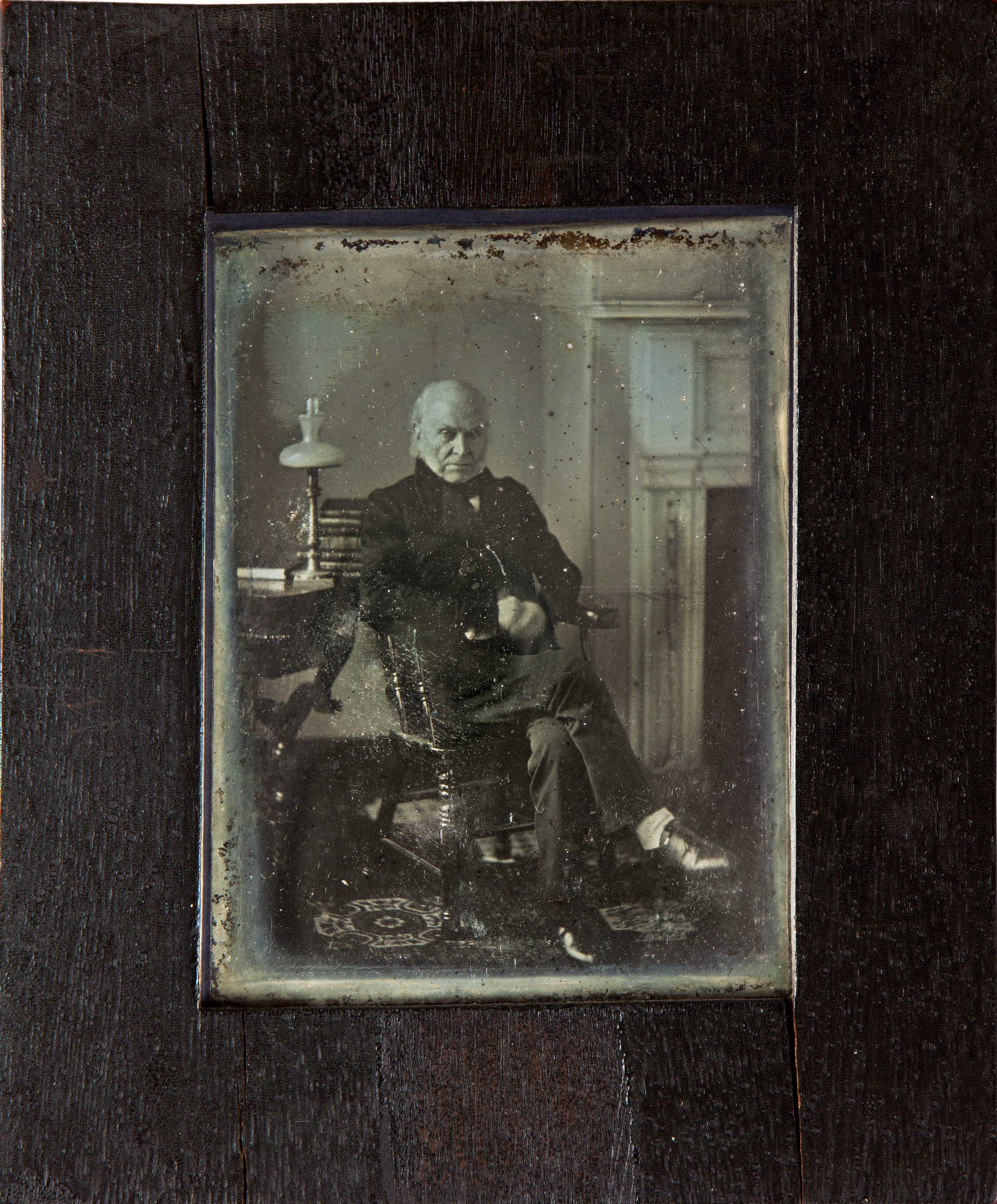 Very old photograph of an old man looking at the camera