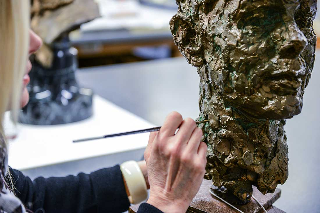 Conservator working on a piece of sculpture