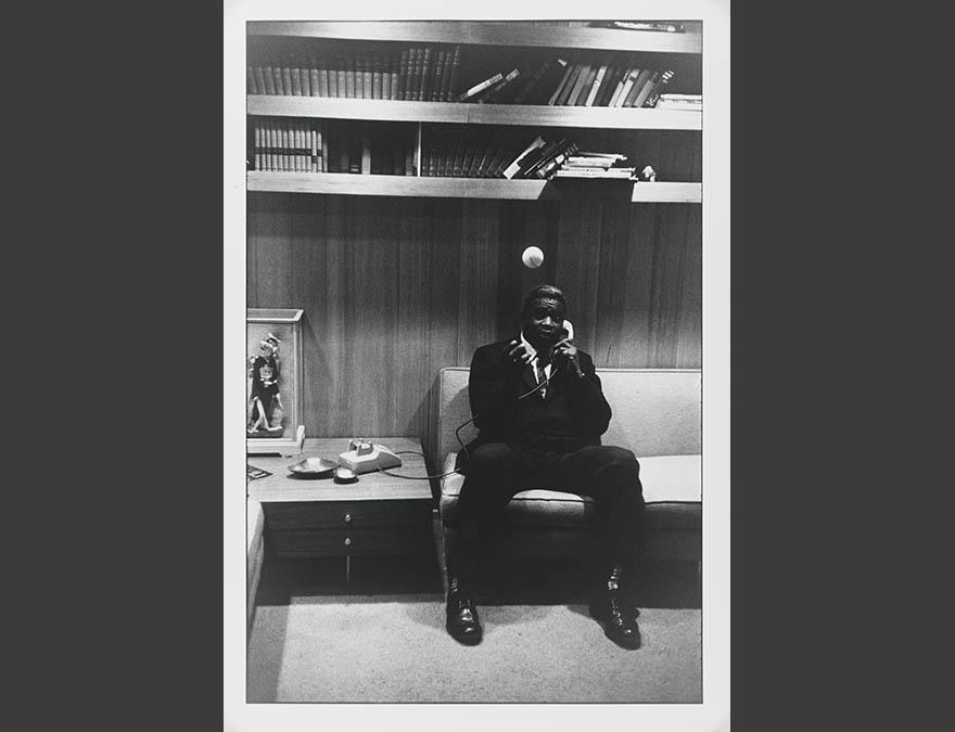 man sitting on a bench in a locker room