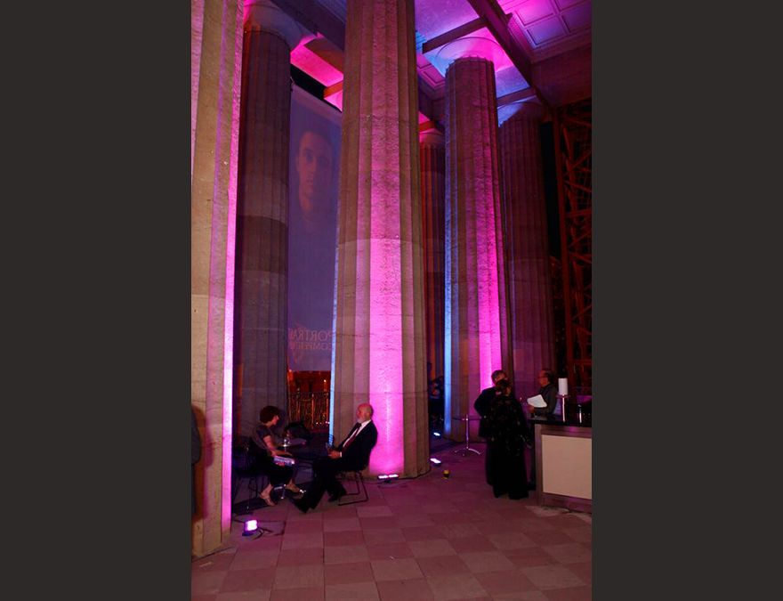 NIght view of party-goers in teh Portico